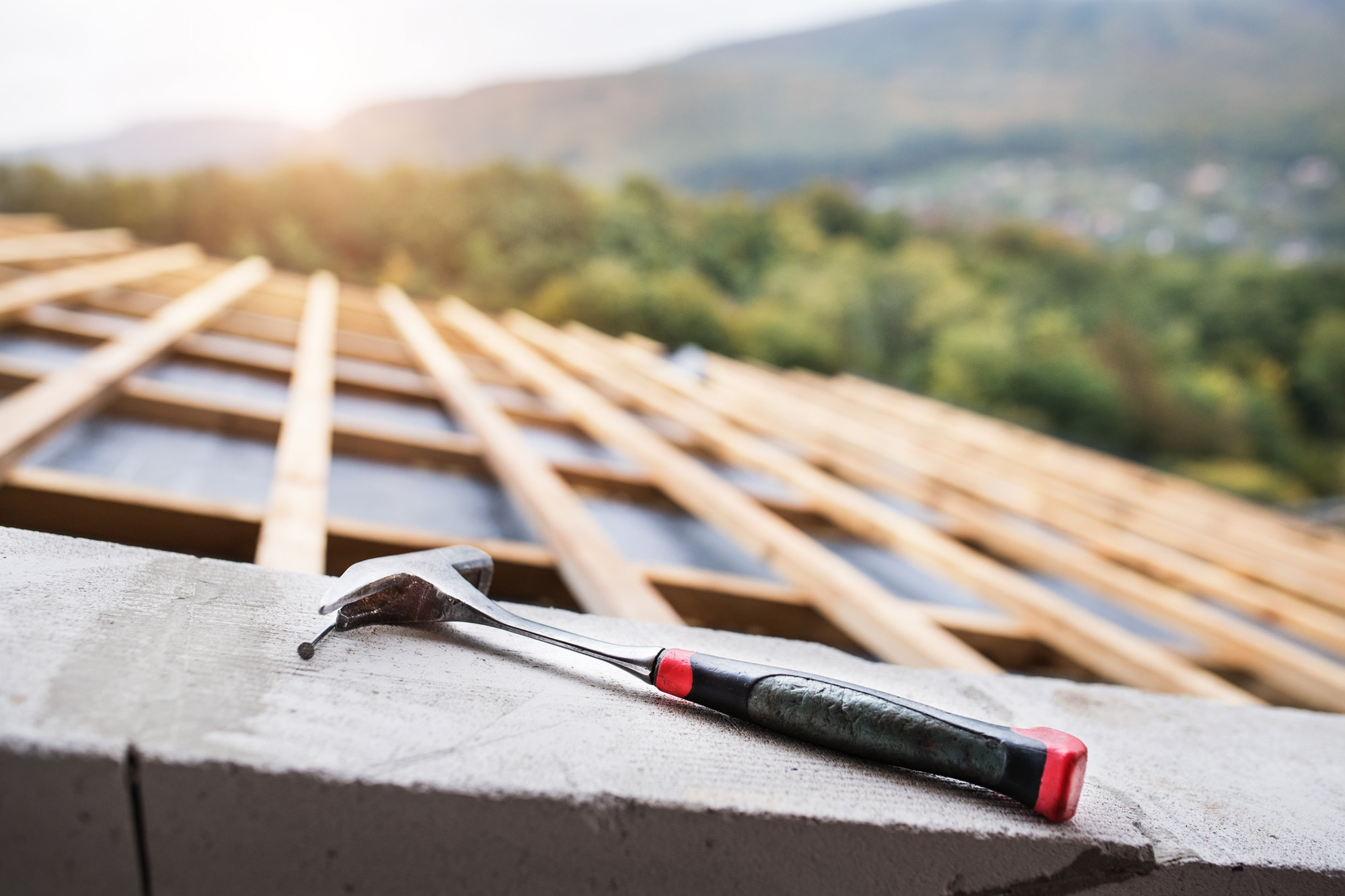 hammer-on-the-roof-on-the-construction-site-